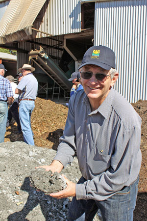 Bill Moorhouse examines the waste-paper mulch used at Sahara Farms.