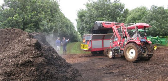 Loading the mulch into the spreader