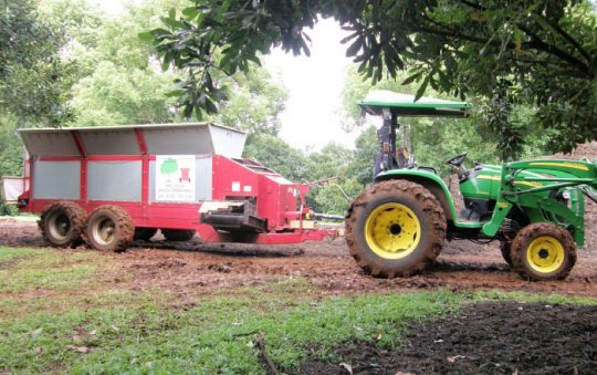 The spreader that was used to apply the mulch in the orchard.